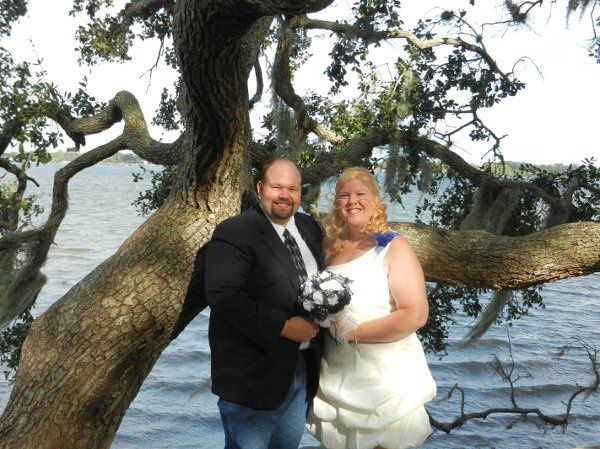 Newlyweds by the trees and water