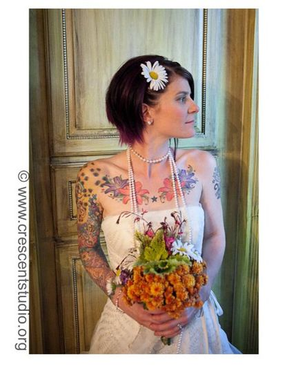 Yes those are beautiful floral tattoos with a simple bouquet from our garden.