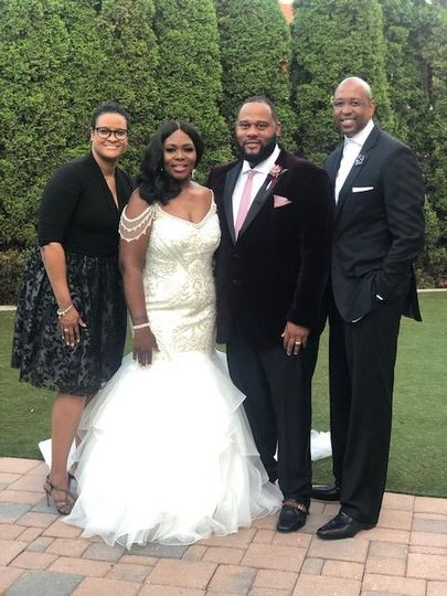 The newlyweds and officiants