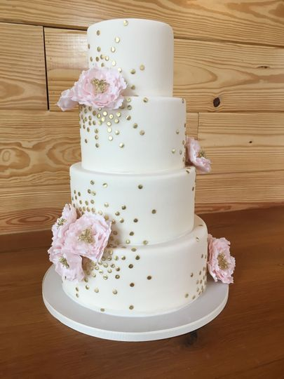 Wedding cake with soft pink flowers