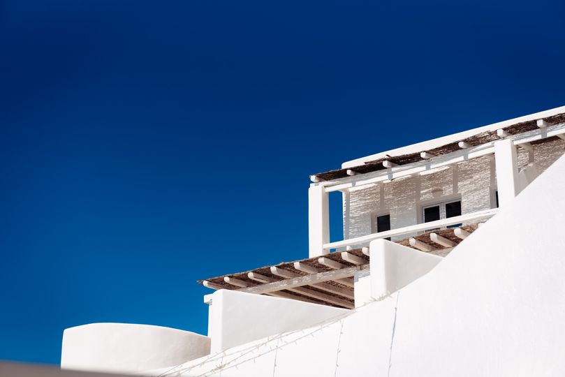 Blue skies, white structures, Kapetanakis Photography