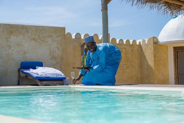 Tmx 1450708598255 Matemwe Retreat Villa Private Butler Serving Drink Alexandria wedding travel