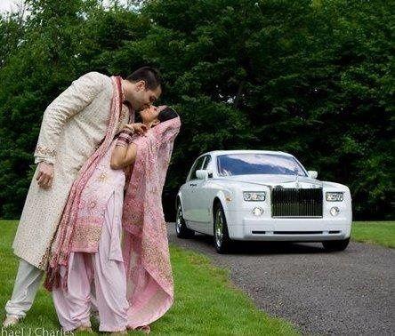 Bride and Groom along side their Phantom Rolls Royce