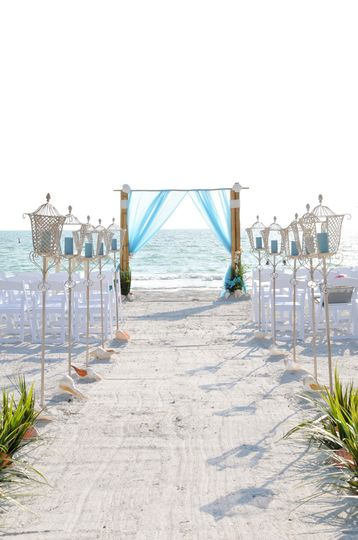 The Elegant Sea package2 post bamboo arch with aqua & white organza sails, elegant wedding chairs...