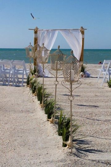 Wedding ceremony package featuring  Bombay torchiere   decor in the aisle