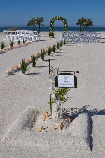 Wedding ceremony package featuring welcome sand castle sign post