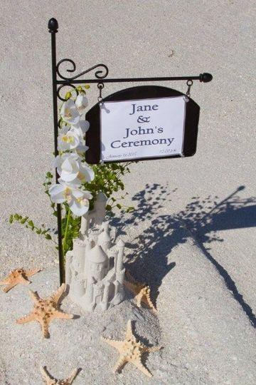 Wedding ceremony sand castle name sign