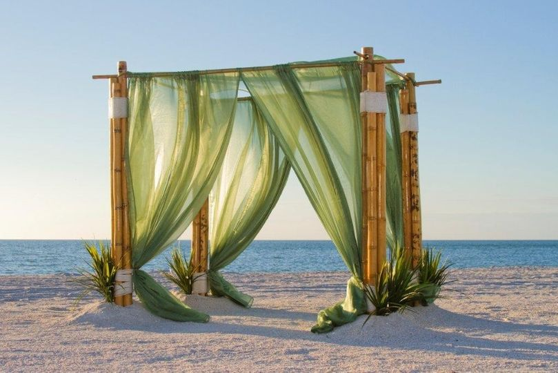 Bamboo outdoor arbor with moss  green organza sails embellished with seagrass and giant shells...