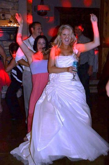 Dancing bride and guest