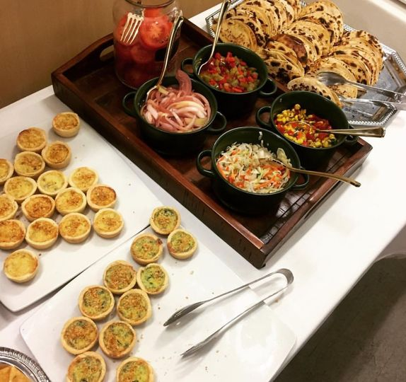 constructed quiche and mint taco station with a variety of toppings