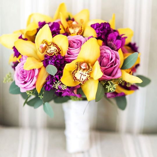 Summer Smile -Yellow cymbidium orchids, lavender roses