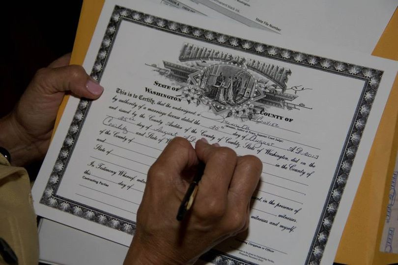Signing the wedding certifcate