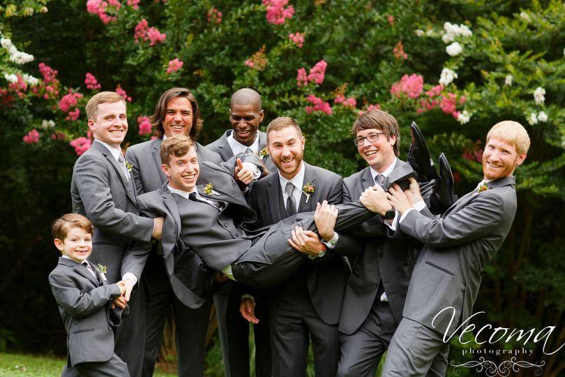 Groomsmen carrying the groom