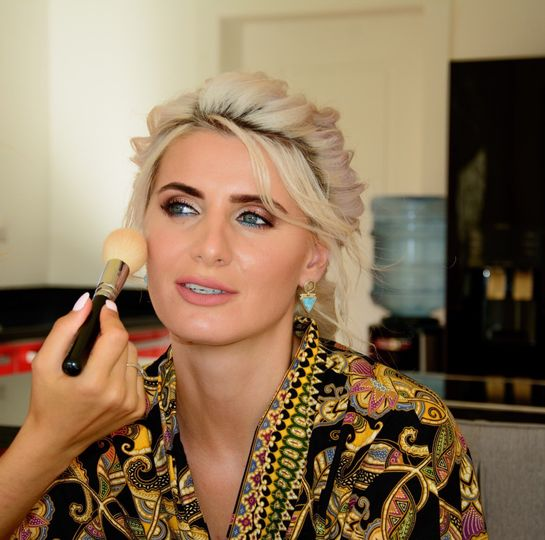Applying bridal makeup