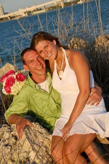 Bride sitting on her groom's lap
