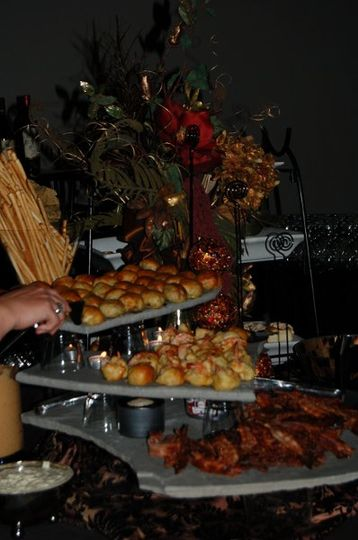 Appetizers are served on stone tiles in a unique presentation by one of Cherokee Conference Center's...