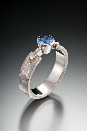 mokume gane engagement ring with blue sappihre