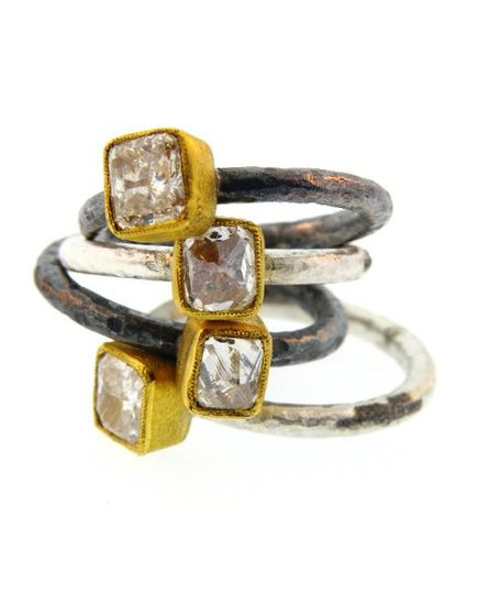 18k gold with impefect cut diamond and silver