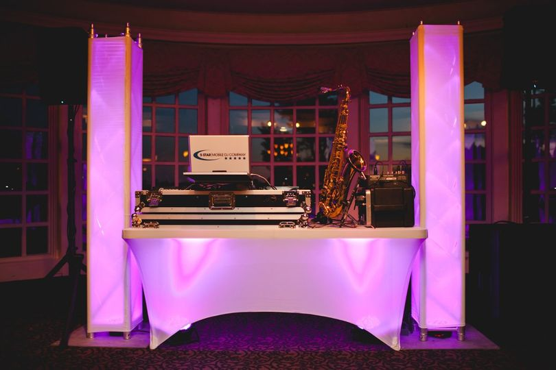 This is our Standard Dj Set up.  Comes with every package, colors interchangeable. *Sax player...