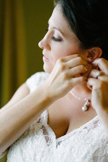 j putting in earrings