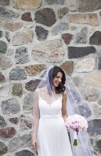 Bride by a stone wall