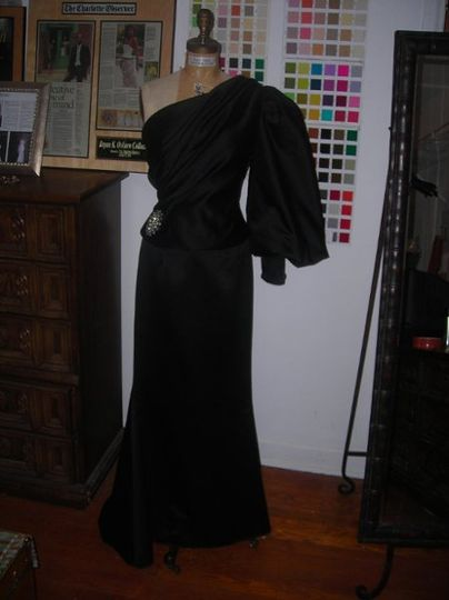 Black silk satin two piece one shoulder gown..Available also in white and ivory