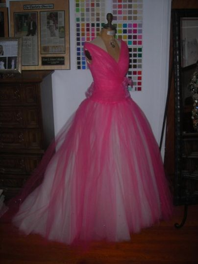 Hot pink tulle, open neckline, full skirt with train. Fully lined in ivory silk..Available in white...