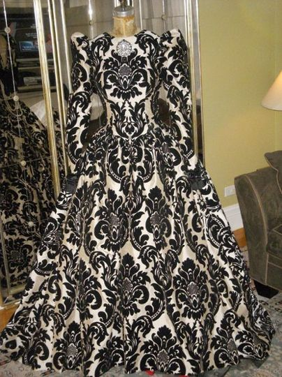 Ivory and black silk velvet tapestry gown.