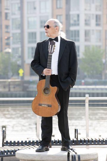 Stuart holding his guitar