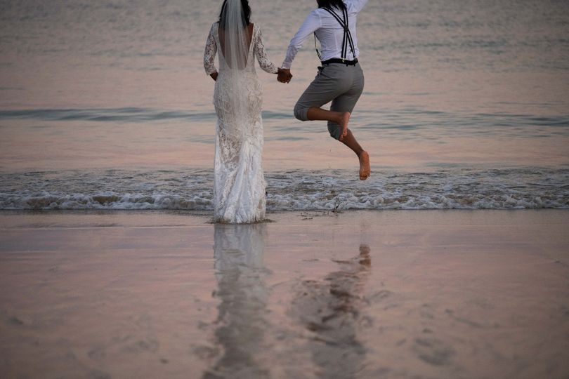 Couple wading into water