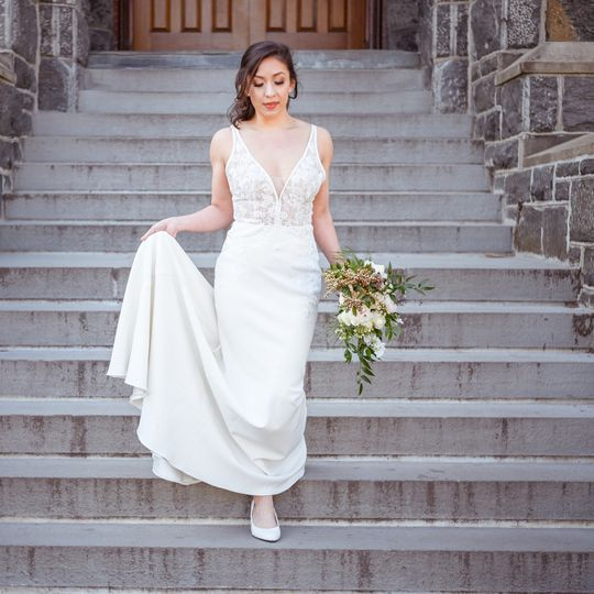 Bride descending the stairs - Portraiture By Christopher