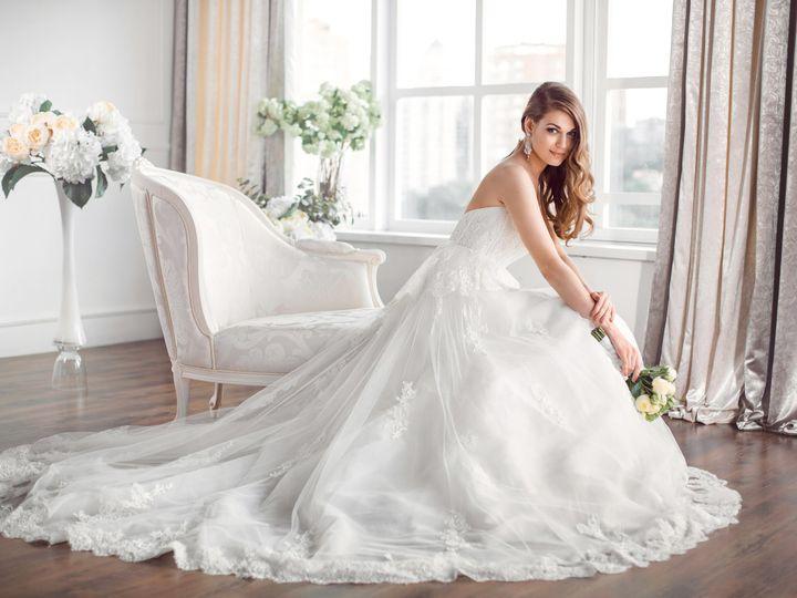 Tmx Wedding Bride In Beautiful Dress Sitting On Sofa Indoors In White Studio Interior Like At Home Trendy Wedding Style Shot In Full Length 51 149525 Orlando, FL wedding beauty