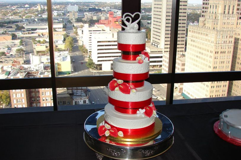 White cake with red ribbon bands