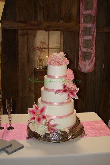 White cake with pink ribbon band
