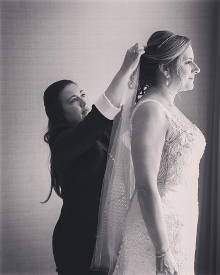 Jennifer making sure every detail on her bride is perfect