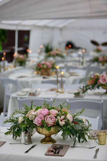 Floral centerpieces and candlelit dinner setup