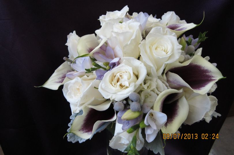 White flower arrangement with purple details