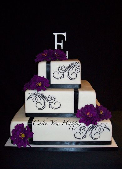 Square cake with black ribbon bands