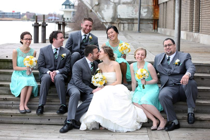 Bridesmaids and groomsmen with the happy couple