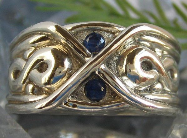 Hand Carved Custom Infinity Ring pictured in 14K White gold with Sapphires.