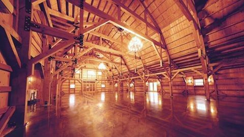 The interior of the Bloomfield Barn has exposed post and beam construction, a soaring 31 foot open...