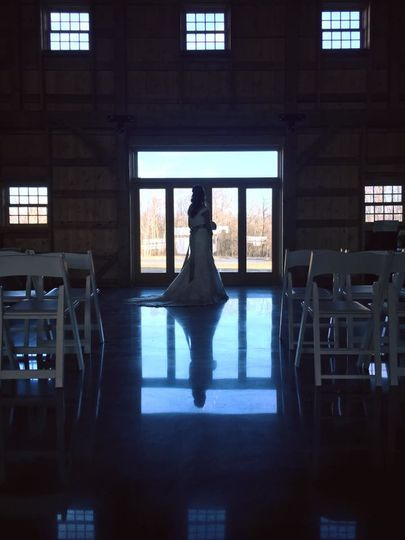 The Bloomfield Barn features two sets of large sliding barn doors behind which are a set of glass...