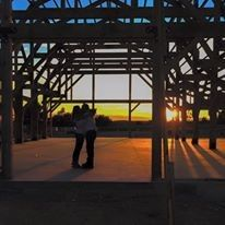 Bloomfield Barn's owners chose a gorgeous sunset under the open frame of the then-under-construction...