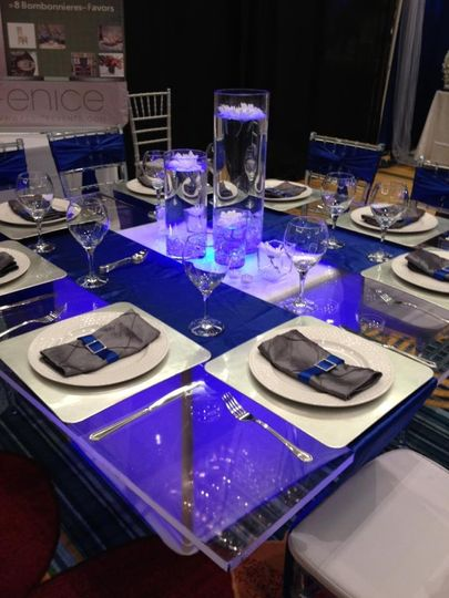 Acrylic squared table with LED light and chiavari chairs.