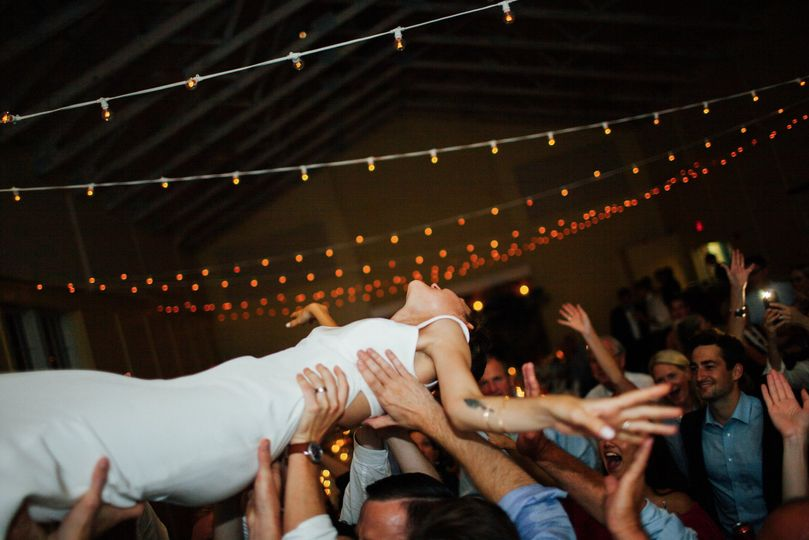 Crowd surfing bride...