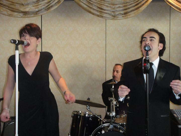 Lead vocalists Renee Savoy and Chris Scialfa