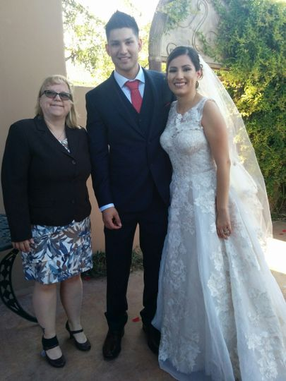 Newlyweds with the officiant