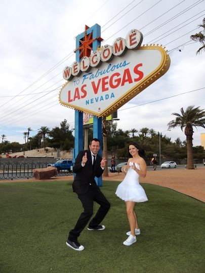 Newlyweds by the Las Vegas signage