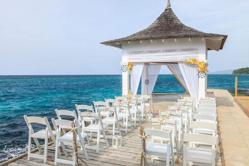 Outdoor ceremony by blue sea