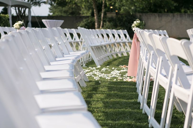 White chairs with petals